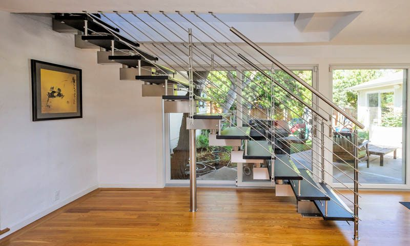 Modern staircases, spiral stairs, curved staircases with wood, glass, or steel steps and railings custom designed and installed by our professional team.