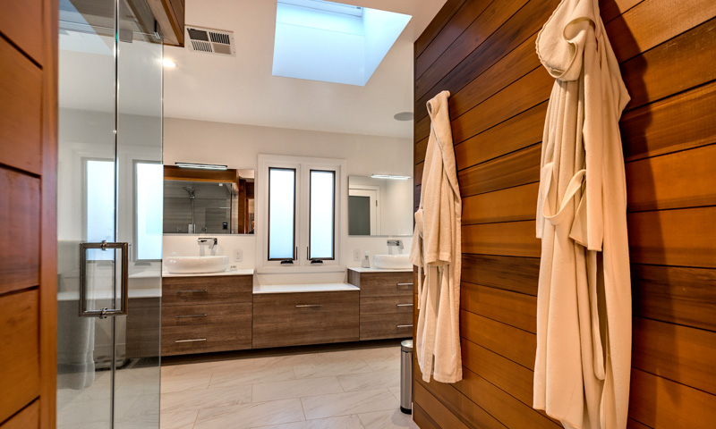 Looking into the master bathroom. Cabinets, mirrors, and LED vanity lighting by BMT Bagni.