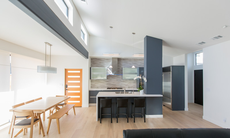 This new home in Palo Alto features a butterfly roof with high clerestory windows and a modern, open kitchen.