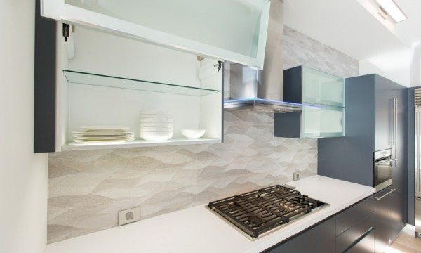Vertically opening wall cabinets from the Aran Cucine Volare collection are as functional as they are beautiful.