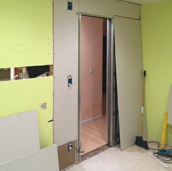 The hallway door of the spare bedroom was filled in.