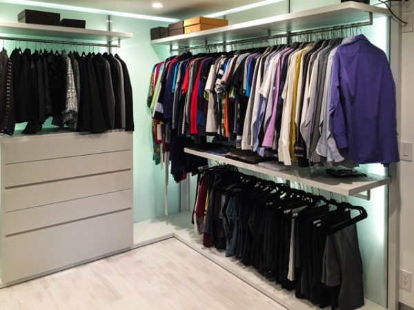 The finished closet has custom designed shelving and hanging rods
