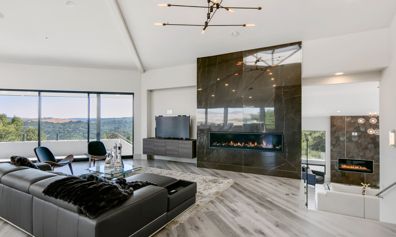 This recently remodeled home in Lafayette, CA, features a living room accent wall with a Montigo gas fireplace and floor-to-ceiling Spanish tile.