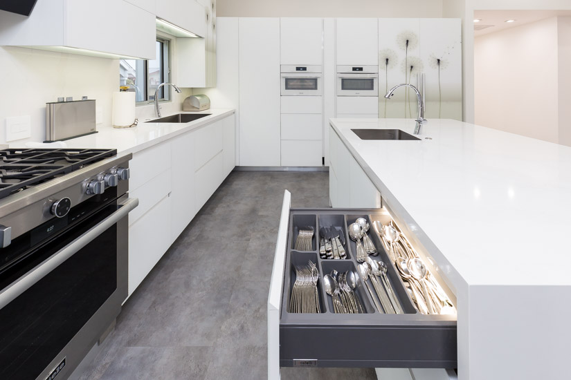 The drawers and the cabinets feature built-in LED lighting.