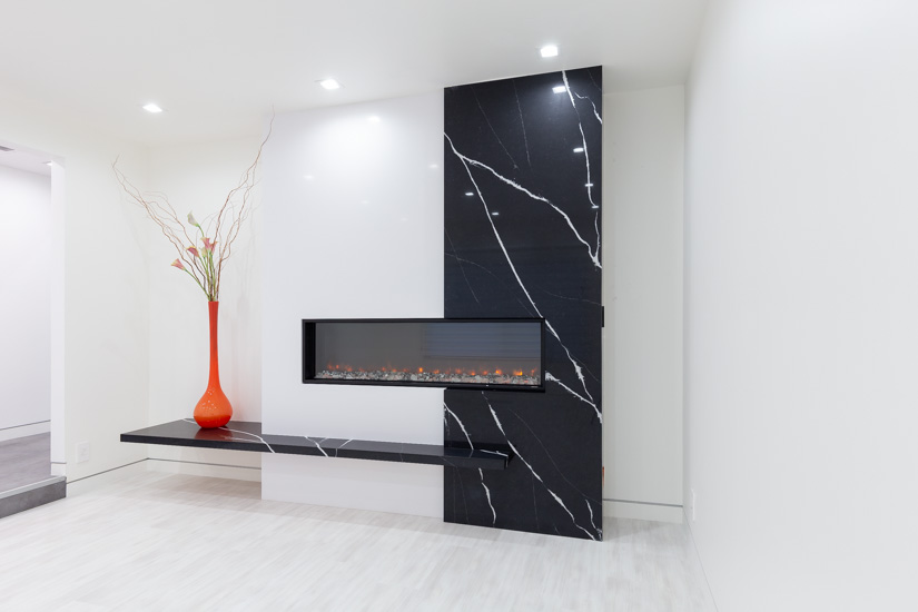 Fireplace feature wall designed with Silestone quartz in Iconic White and Marquina.