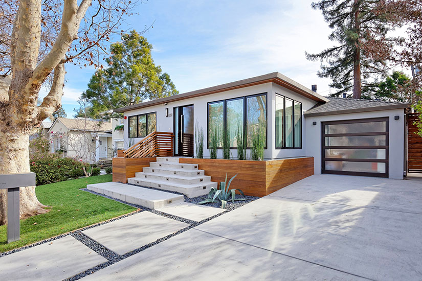 Modern house design with cement staircase and large picture windows in San Mateo