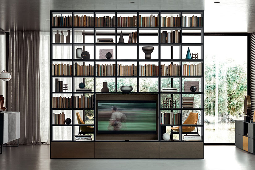 Open bookcase and entertainment center create great home office design.