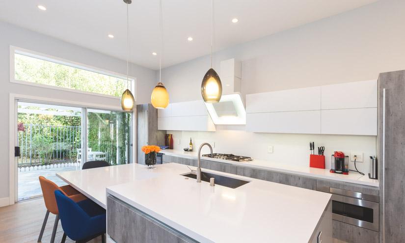 Modern kitchen with large, sliding glass door.