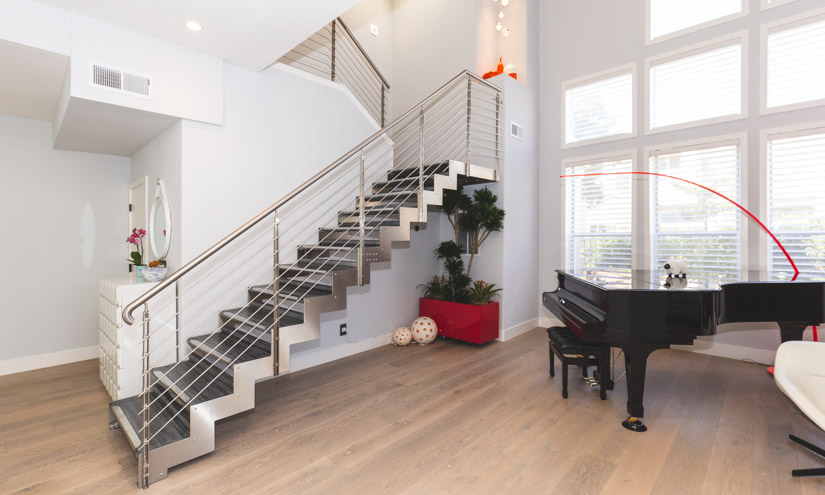 After picture of the open, stainless steel and wood staircase.