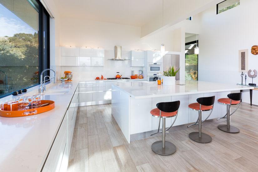 Modern white kitchen with orange accents in Alamo, California